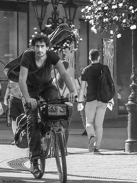 Street Photography - The musician on bike